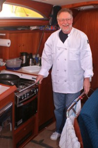"Chef Dennis at work in Sancerre's fully equipped galley. ""With a 14.8 foot beam, we could line dance in here."""